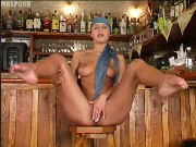 Hot MILF masturbates in a bar until orgasm...